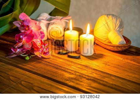 Spa Concept Of Pink Orchid Flower, Thai Herbal Compress Balls In Basket, Towels, Zen Stones And Cand