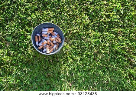 Ashtray in grass