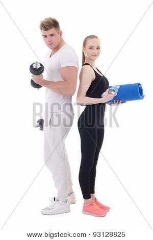 Man And Woman In Sportswear With Dumbbells And Yoga Mat Isolated On White