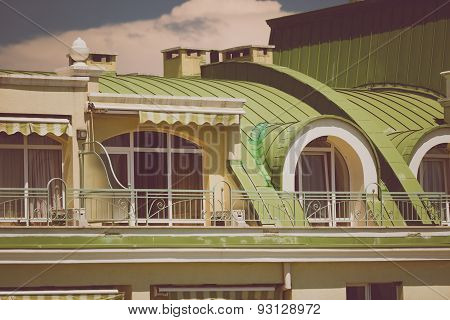 Toned Photo Of Terrace Under Green Metal Roof At Classic Building