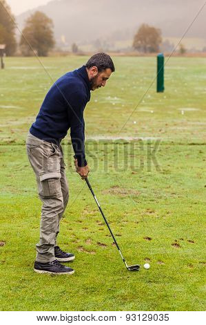 Playing At Driving Range
