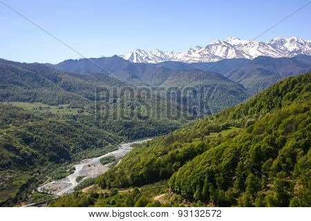 Mountain Valley, A Top View Of The River Bed.landscape With Mountains Trees And A River.