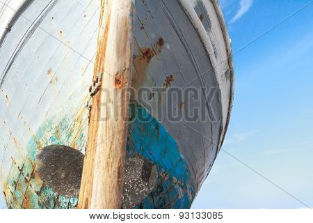 Front View Of Damaged With Time Wooden Fishing Boat On Greek Kos Island Shore