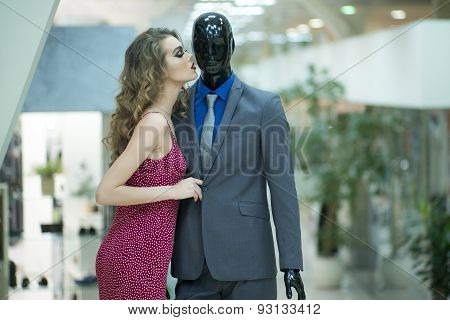Sensual Girl And Mannequin