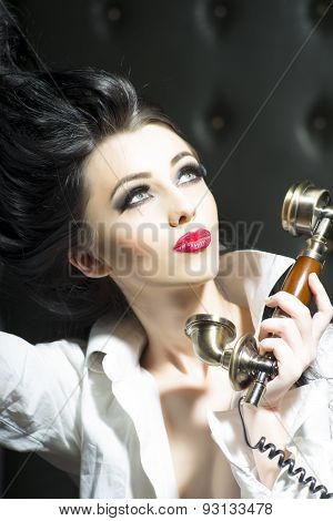 Passionate Woman And Gold Telephone