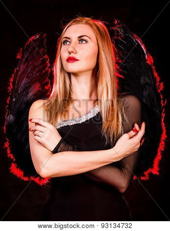 Beautiful Young Woman With Black Angel Wings
