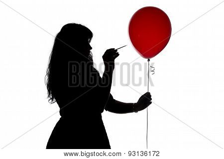 Image woman pierced with a needle balloon