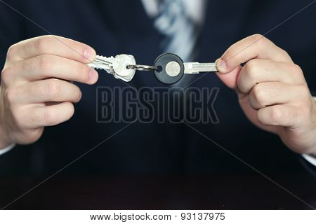 Businessman with keys in his hand, closeup