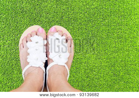 Woman Feet On Grass