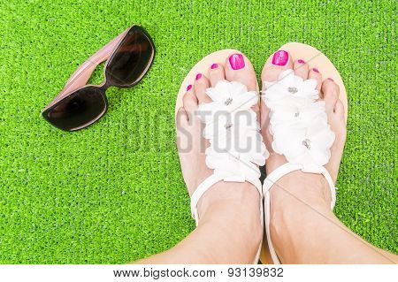 Woman Feet And Sunglasses