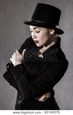 Beautiful Young Woman In A Black Hat
