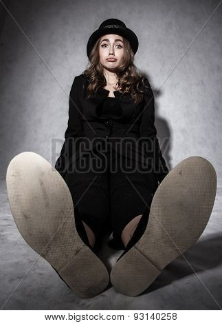 Funny Young Woman In A Black Costume