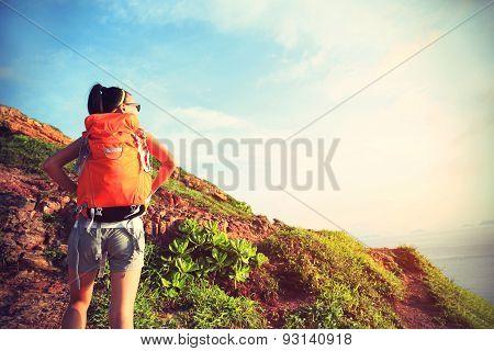 woman hiker climbing on seaside mountian trail,vintage effect