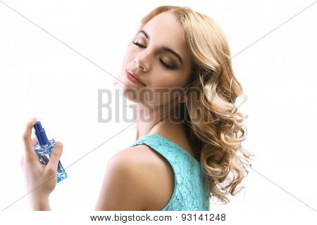 Beautiful young woman with perfume bottle isolated on white