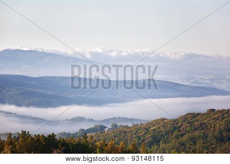 Morning Fog Over The Village And Hills In Tuscany
