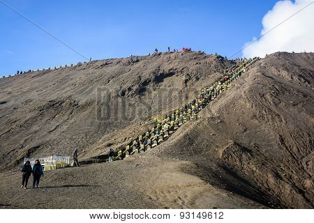 Tourists Climbing Stairway To The Rim Of Mount Bromo