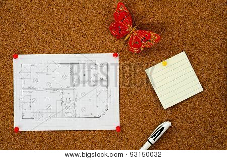 Floor plan and note on a corkboard