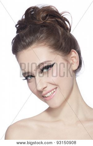Portrait of young slim beautiful happy young woman with stylish cat eyes and hair bun over white background
