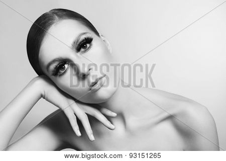 Horizontal black and white portrait of young beautiful woman with stylish false eyelashes