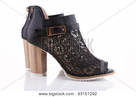 Female shoes with black lace, white sole and a wooden heel, isolated on white