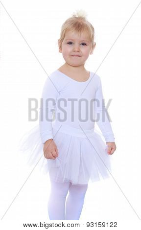 Adorable little athlete in a white tracksuit