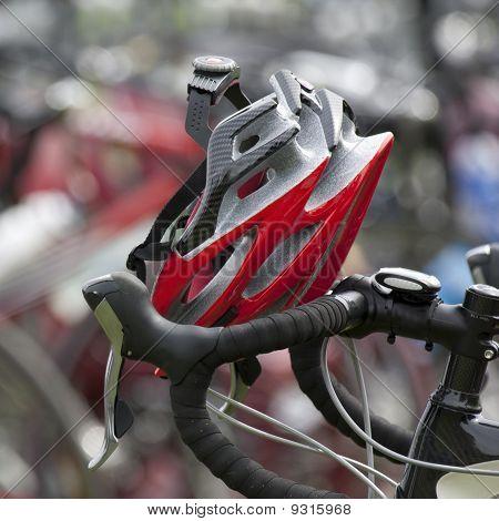 Red helmet resting on handlebars