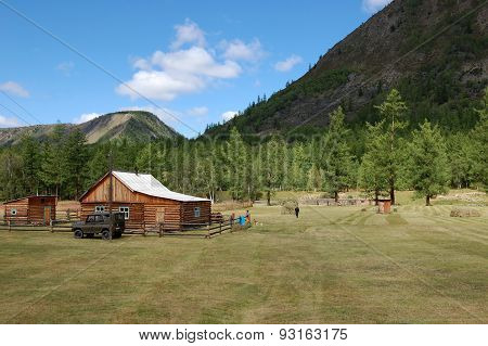 Rural wooden house in the mountain valley.