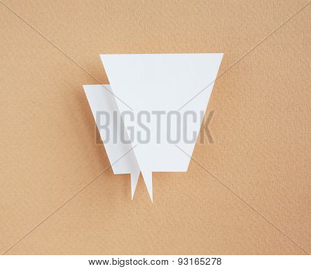 paper speech bubble on brown background