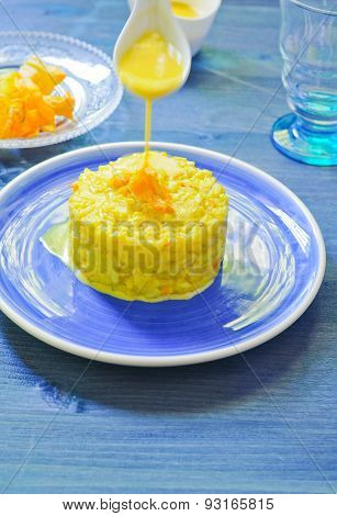 Risotto with pumpkin flowers with saffron cream
