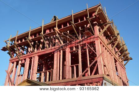 New House- Construction Concept Against The Blue Sky