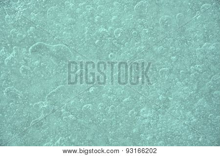 Icy Background With Bubbles. Closeup View, Winter Season
