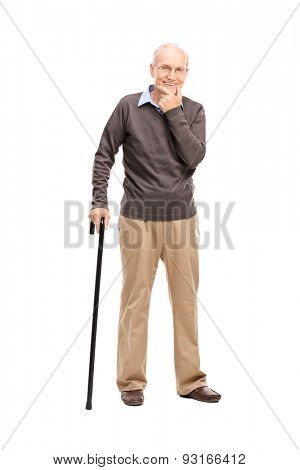 Full length portrait of a casual senior with a black wooden cane posing isolated on white background