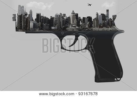 Double Exposure of Pistol and City