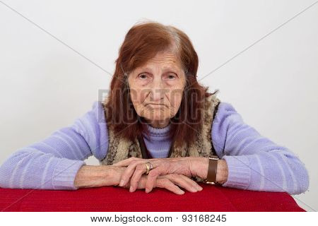 Portrait of an elderly woman with sad face expression
