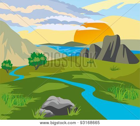 River valley surrounded by mountains at sunset