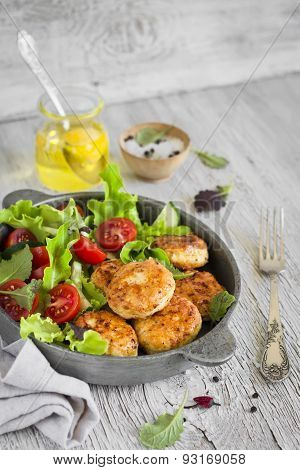 Chicken Cutlet With Fresh Vegetable Salad In A Vintage Pan On A Light Wooden Background