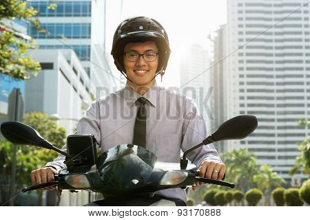 Chinese Businessman Commuter Using Scooter Motorcycle In City