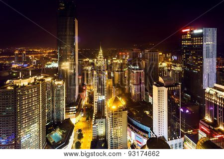 High angle view of illuminated skyline and modern buildings at night in chongqing