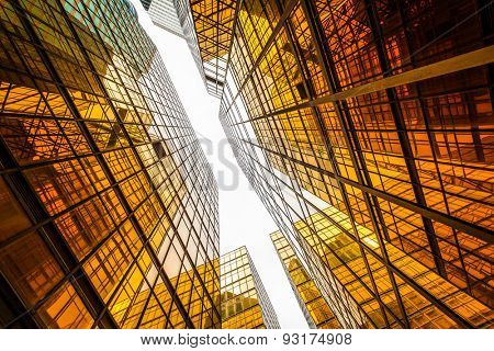 low angle view of modern skyscraper exterior and sky in modern city