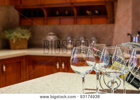 Banquet wine utensils on table with part of kitchen as background