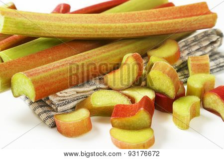 detail of fresh rhubarb on checkered dishtowel