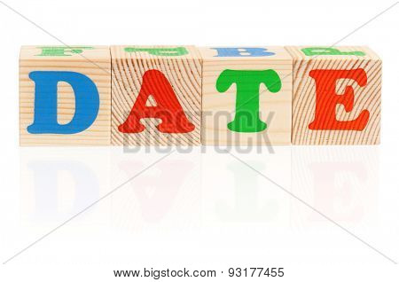 Date word formed by wood alphabet blocks on white background