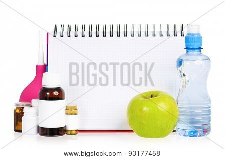 Pills and blank notepad for text, isolated on white background