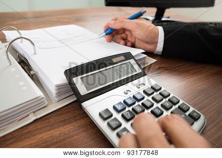 Businessman Calculating Invoice