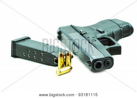 9mm bullets and black gun pistol isolated on white background.