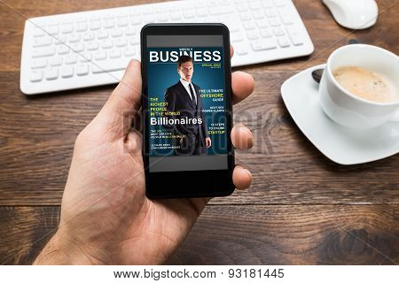 Person Hands With Mobile Phone Showing Business News