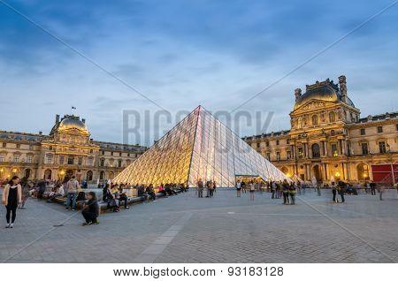 Paris, France - May 14, 2015: Tourist Visit Louvre Museum At Dusk