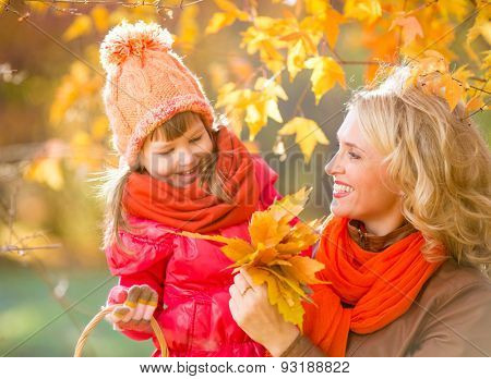 Happy family outdoor in fall or autumn