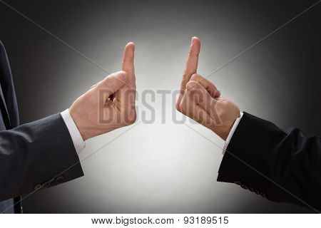 Two Businessman Showing Fuck Sign