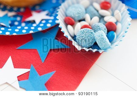 american independence day, celebration, patriotism and holidays concept - close up of glazed sweet candies with stars decoration at 4th july theme party